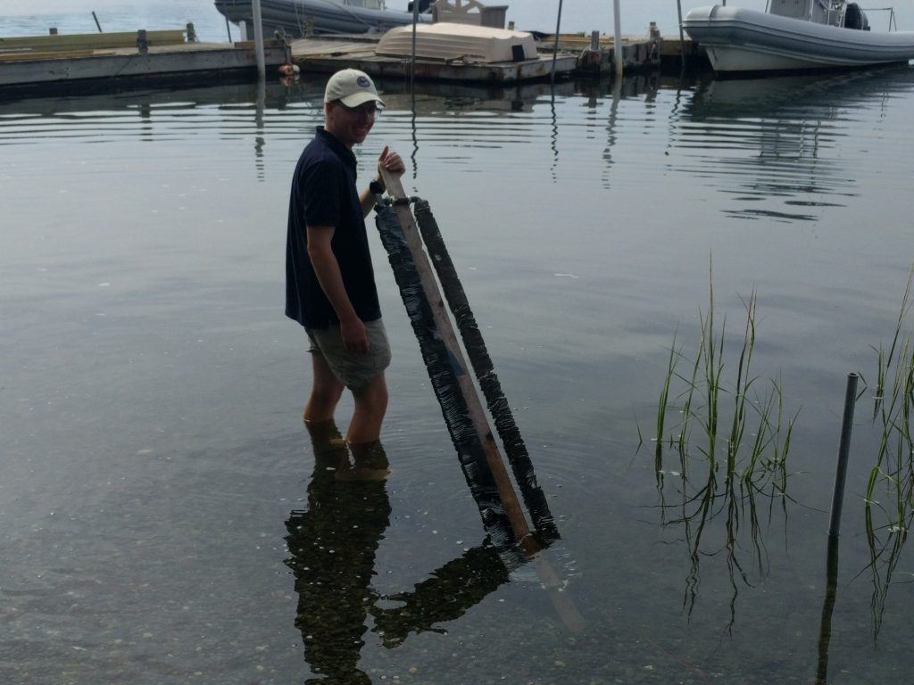 Evan laying down the seawater ground connection device